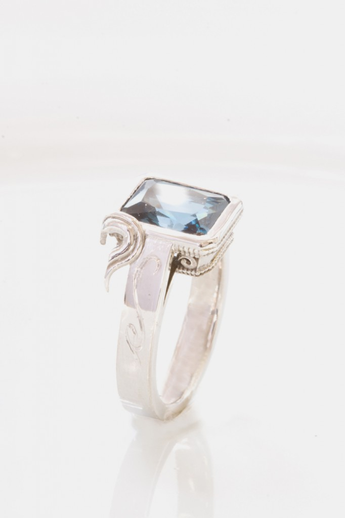 silver ring with blue cubic zirconia